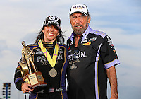 Sept. 1, 2014; Clermont, IN, USA; NHRA  funny car driver Alexis DeJoria (left) poses with her father John Paul DeJoria as they celebrate after winning the US Nationals at Lucas Oil Raceway. Mandatory Credit: Mark J. Rebilas-USA TODAY Sports