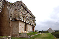 False Arch, Corner with several masks of Chaac, God of the rain, façade, Temple of the Magician or House of the Dwarf in the distance, Governor?s Palace, 900-1000 AD, Puuc architecture, Uxmal late classical Mayan site, Yucatan, Mexico Picture by Manuel Cohen