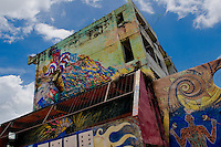 Afro-Cuban traditional themes, showing colorful dance, spirits and rituals, painted on house walls in Santiago de Cuba, Cuba, August 2, 2009. The Palo religion (Las Reglas de Congo) belongs to the group of syncretic religions which developed in Cuba amongst the black slaves, originally brought from Congo during the colonial period. Palo, having its roots in spiritual concepts of the indigenous people in Africa, worships the spirits and natural powers but can often give them faces and names known from the Christian dogma. Although there have been strong religious restrictions during the decades of the Cuban Revolution, the majority of Cubans still consult their problems with practitioners of some Afro Cuban religion.