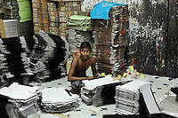Young worker in shoebox factory in Dharavi Slum