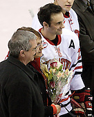 Denis Chisholm (Northeastern - 24) and parents - The Northeastern University Huskies defeated the Boston College Eagles 2-1 OT in the NU senior night game on Friday, March 6, 2009 at Matthews Arena in Boston, Massachusetts.