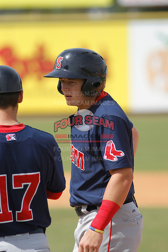 Salem Red Sox center fielder Tate Matheny (19) on base talking to coach Reed Gragnani (17) during a game against the Down East Wood Ducks  at Grainger Stadium on April 16, 2017 in Kinston, North Carolina. Salem defeated Down East 9-2. (Robert Gurganus/Four Seam Images)