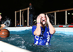 Chi Omega jumper Jenna Hollinder comes out of the water at the University of Kentucky Phi Sigma Kappa Polar Plunge philanthropy event at South Campus benefitting the Special Olympics in Lexington, Ky., on Thursday, November 14, 2013. Photo by Tessa Lighty | Staff