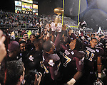 Mississippi State players carry the Golden Egg after a 31-3 win over Ole Miss in Starkville, Miss. on Saturday, November 26, 2011.