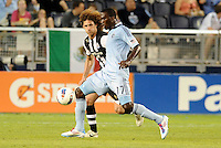 Sporting KC forward C.J Sapong (17) watched by Newcastle United defender Fabricio Coloccini... Sporting Kansas City and Newcastle United played to a 0-0 tie in an international friendly at LIVESTRONG Sporting Park, Kansas City, Kansas.