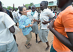 Loreto Sister Maria Suetta dances with students at the Loreto Secondary School in Rumbek, South Sudan. The school is run by the Institute for the Blessed Virgin Mary--the Loreto Sisters--of Ireland. Suetta is from Gibraltar.
