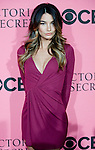 Victoria's Secret Angel Lily Aldridge poses for photos on the Pink Carpet before Tuesday's screening party for the 2011 Victoria's Secret Fashion Show.