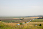 Israel, Jezreel Valley, a view south as seen from Tel Megiddo National park. Megiddo is a tel (hill) made of 26 layers of the ruins of ancient cities in a strategic location at the head of a pass through the Carmel Ridge, which overlooks the Valley of Jezreel from the west.
