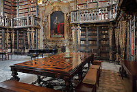 Black Room of the Joanina Library, or Biblioteca Joanina, a Baroque library built 1717-28 by Gaspar Ferreira, part of the University of Coimbra General Library, in Coimbra, Portugal. The bookshelves were made, gilded and lacquered by Manuel da Silva and the portrait is of King John V or Joao V, 1689-1750, by Domenico Dupra, 1725. The Casa da Livraria was built during the reign of King John V or Joao V, and consists of the Green Room, Red Room and Black Room, with 250,000 books dating from the 16th - 18th centuries. The library is part of the Faculty of Law and the University is housed in the buildings of the Royal Palace of Coimbra. The building is classified as a national monument and UNESCO World Heritage Site. Picture by Manuel Cohen