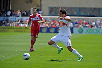 New York forward Dwayne De Rosario (11) plays the ball as Chicago midfielder Marco Pappa (16) tracks backward.  The Chicago Fire tied the New York Red Bulls 1-1 at Toyota Park in Bridgeview, IL on June 26, 2011.