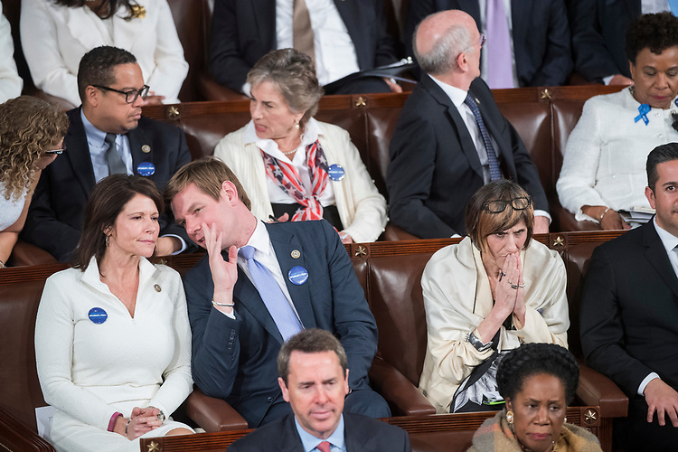 UNITED STATES - FEBRUARY 28: Center row from left, Reps. Cheri Bustos, D-Ill., Eric Swalwell, D-Calif., Rosa DeLauro, D-Conn., and Ben Ray Luján, D-N.M., listen to President Donald Trump address a joint session of Congress in the Capitol, February 28, 2017. Rep. (Photo By Tom Williams/CQ Roll Call)