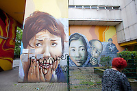 Murals and graffiti on a housing estate in Berlin's Kreuzberg district..