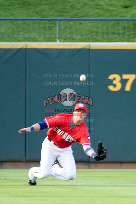 Outfielder Craig Gentry ##23 of the Round Rock Express makes a diving catch against the Oklahoma City RedHawks on April 26, 2011 at the Dell Diamond in Round Rock, Texas. (Photo by Andrew Woolley / Four Seam Images)