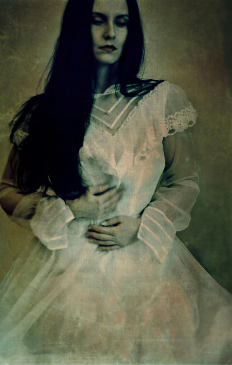 atmospheric photo of beautiful young caucasian woman looking with sorrow in retro style