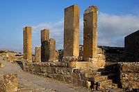 General view of the Temple of Pietas Augusta (August Piety), 2nd century, in Dougga, Tunisia, pictured on January 31, 2008, in the afternoon. Dougga has been occupied since the 2nd Millennium BC, well before the Phoenicians arrived in Tunisia. It was ruled by Carthage from the 4th century BC, then by Numidians, who called it Thugga and finally taken over by the Romans in the 2nd century. Situated in the north of Tunisia, the site became a UNESCO World Heritage Site in 1997. The Temple of Pietas Augusta features a semi-circular cella and a tetrastyle Corinthian portico on a podium. The Romans allowed the worship of a number local deities, worshiped in individual temples, and supported its integration in a common religion. Picture by Manuel Cohen.