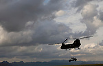 A US Army Chinook hauls away a humvee destroyed by a double-stacked antitank mine in Kandahar province on Saturday, March 31, 2007.