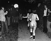 STREAKING craze hits University of California at Berkeley in 1974 as these three students run through the crowd in Berkeley near the Campus. .(photo by Ron Riesterer)