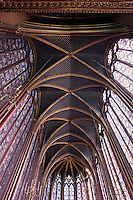 View from below of the clerestories, the apse and the ceiling of the nave in the upper chapel of La Sainte-Chapelle (The Holy Chapel), 1248, Paris, France. Fifteen huge mid-13th century windows fill the nave and apse. La Sainte-Chapelle was commissioned by King Louis IX of France to house his collection of Passion Relics, including the Crown of Thorns. The Sainte-Chapelle is considered among the highest achievements of the Rayonnant period of Gothic architecture. Picture by Manuel Cohen