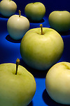 Green apples on blue background abstract pattern