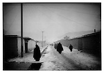 Monks returning from dawn prayers, Labrang Monastery, Amdo, Tibet.