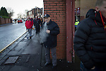 Motherwell 3 Dundee 1, 12/12/2015. Fir Park, Scottish Premiership. An elderly spectator smoking an e-cigarette waiting for friends outside the Davie Cooper Stand at Fir Park, home to Motherwell Football Club, before they played Dundee in a Scottish Premiership fixture. Formed in 1886, the  home side has played at Fir Park since 1895. Motherwell won the match by three goals to one, watched by a crowd of 3512 spectators. Photo by Colin McPherson.