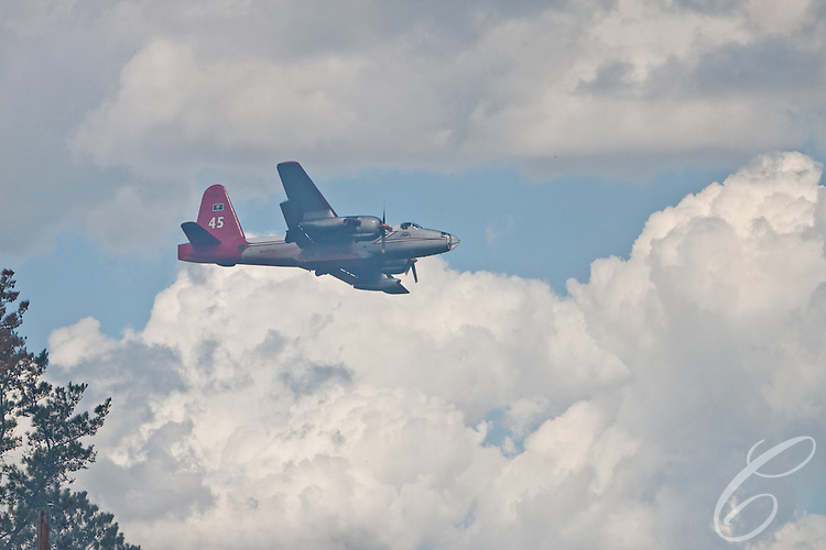 A fire fighting P2V-7  aerial tanker lines up a retardant drop on the Dyer Mill fire in Grimes County, Texas on June 21, 2011.