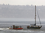 A United State Coast Guard Patrol boat escorts a sail board from a protection area surrounding a Washington State ferry near Seattle on August 20, 2009.  The personnel and boats, from the 13th Coast Guard District, provide protection from possible terrorists attacks in support of the Homeland Security for ferries operating from Seattle area ferry terminals to those on the Kitsap Peninsula, Vashion Island, and Bainbridge Island.    © 2009. All Rights Reserved. Jim Bryant