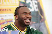 Client: Kohl's <br /> Nick Collins greets fans at a West Allis Kohl's parking lot in late May, 2011. The Super Bowl champion defensive end signed autographs for three hours.