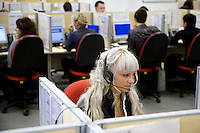 A woman operates at the call centre of Russia's RusFinance bank in Moscow. .Picture by Justin Jin.
