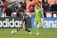 DC United midfielder Andy Najar (14) shield the ball against Seattle Sounders defender Tyson Wahl (5)   DC United defeated The Seattle Sounders 2-1 at  RFK Stadium, Wednesday May 4, 2011.