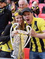 FUSSBALL  CHAMPIONS LEAGUE  SAISON 2012/2013  FINALE  Borussia Dortmund - FC Bayern Muenchen         25.05.2013 BVB Fans mit einem Papp-Champions League Pokal