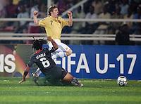 Zachary Herold (6) slide tackles Iker Muniain (7). Spain defeated the U.S. Under-17 Men National Team  2-1 at Sani Abacha Stadium in Kano, Nigeria on October 26, 2009.