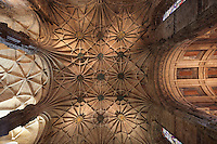 Looking up at the ceiling of the nave with its ornate bosses in the Jeronimos Monastery or Hieronymites Monastery, a monastery of the Order of St Jerome, built in the 16th century in Late Gothic Manueline style, Belem, Lisbon, Portugal. The monastic complex includes the church with portal by Joao de Castilho, cloisters, and Chapel of St Jerome. The monastery is listed as a UNESCO World Heritage Site. Picture by Manuel Cohen