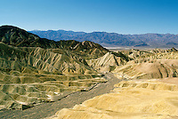Death Valley National Park, California, CA, USA - View of Eroded Landscape and Mountains, from Zabriskie Point in the Amargosa Range, Panamint Mountains in Distance