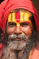 Pashupatinath, Nepal.  Sadhu, a Hindu Ascetic or Holy Man.  The stylized trident on his forehead marks him as a devotee of Shiva.
