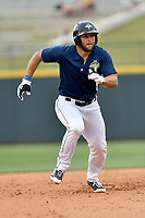 Left fielder Tim Tebow (15) of the Columbia Fireflies runs between second and third in a game against the Lexington Legends on Sunday, April 23, 2017, at Spirit Communications Park in Columbia, South Carolina. Lexington won, 4-2. (Tom Priddy/Four Seam Images)
