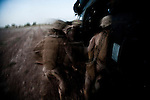"10/10/2010 Helmand Province, Afghanistan.US Marines load a patient onto a US Army Medevac Helicopter as night falls in Helmand Province, Afghanistan...The Helicopter Medevac teams of Task Force Destiny, based at Forward Operating Base Dwyer in Afghanistan's war-torn Helmand Province have a tough job. Servicing a large area that includes still restive southern Marjah, and much of the Helmand River Valley, TF Destiny answers the call to transport gravely wounded US Marines and Afghan civilians from the point of injury in the field to Role 3 trauma centers on bases in the area--often times landing under fire to extract Marines and soldiers that would otherwise succumb to their wounds. After the Medevac helicopter and it's ""chase"" UH-60 Blackhawk companion aircraft get a call, they can be on the ground picking up a patient in as little as 20 minutes--delivering the fallen to a surgical theater within what flight medics refer to as ""the golden hour""--or the hour after a catastrophic injury during which a patients transfer from basic battlefield triage care to a modern trauma surgical unit can mean the difference between life and death. ."