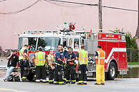 MAMARONECK, NY - AUGUST 28: Members of the local Volunteer Fire Department, ready to assist with any emergencies, stationed on Mamaroneck Avenue in the Village of Mamaroneck, New York on Sunday August 28, 2011 in the aftermath of Hurricane Irene.