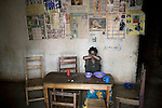 BUKAVU, DEMOCRATIC REPUBLIC OF CONGO - OCTOBER 30: Janette Vumilia, age 30, eats a meal in the living room of her small house on October 30, 2007 Bukavu, DRC. Janette was abducted, held captive and raped by rebels in the DRC conflict. Her hands were amputated before she was finally released. Janette lives with her husband and four children, which is quite unusual, as many men abandon their wives or daughters if they have been raped. The DRC conflict has seen an unprecedented high rate of rape and sexual abuse of women. The culprits are both different rebel groups and government soldiers and very few are punished. About 27,000 sexual assaults were reported in South Kivu province alone in 2006, according to the United Nations. (Photo by Per-Anders Pettersson)
