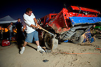 Demolition Derby - Participants preparing their cars inbetween heats. Antelope Valley Fair, Lancaster, Southern California, California, United States, North America. September 2008, ©Stephen Blake Farrington