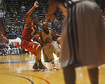 "Ole Miss guard Chris Warren (12)  drives at C.M. ""Tad"" Smith in Oxford, Miss. on Saturday, March 5, 2010. Mississippi won 84-74."