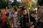The Chelsea Flower Show, CHELSEA PENSIONER, LAST DAY HAVING BOUGHT FLOWERS THAT HAVE BEEN ON DISPLAY. The English Season published by Pavilon Books 1987
