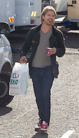 Cardonald - Glasgow, Scotland. Brad Pitt body double goes for a coffee during filming at the super market set in Cardonald of World War Z in Glasgow..Picture: Maurice McDonald/Universal News And Sport (Scotland). 20 August 2011. www.unpixs.com..