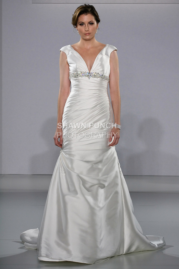 Model walks runway in a Guinevere wedding dress from the Sottero and Midgley Spring 2013 collection, at The Couture Show, during New York Bridal Fashion Week, on October 14, 2012.