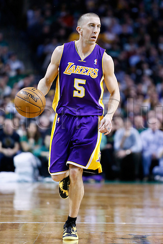07.02.2013. Boston, Mass.  Los Angeles Lakers point guard Steve Blake (5) brings the ball upcourt during the Boston Celtics 116-95 victory over the Los Angeles Lakers at the TD Garden, Boston, Massachusetts, USA.