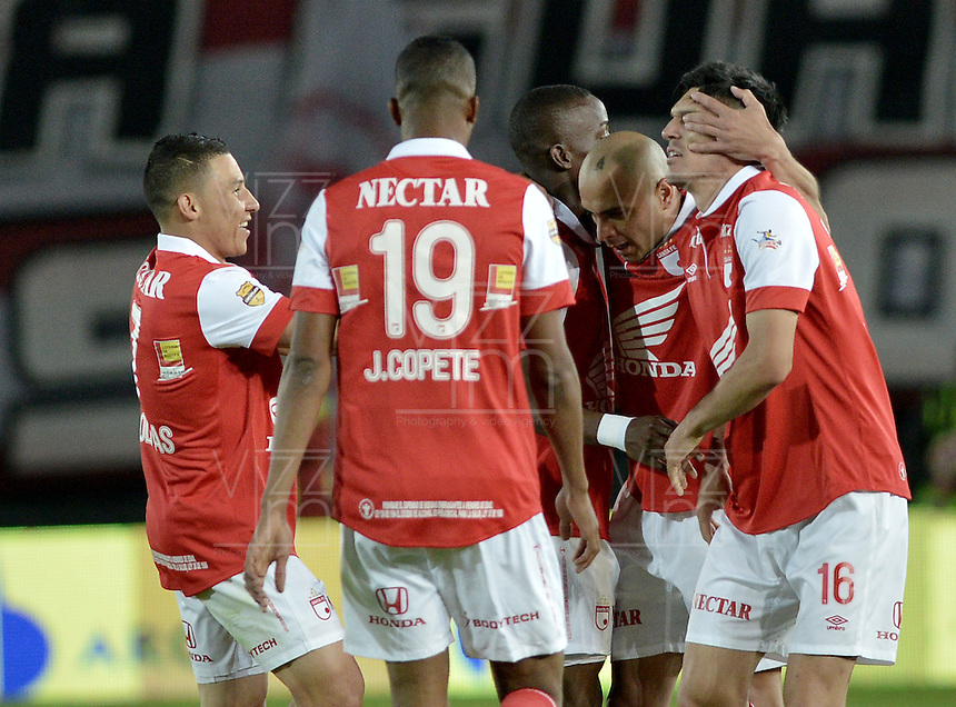 BOGOTÁ -COLOMBIA, 07-05-2014. Jugadores de Independiente Santa Fe celebran un gol en contra del Atlético Nacional durante partido de ida por las semifinales de la Liga Postobón  I 2014 jugado en el estadio Nemesio Camacho el Campín de la ciudad de Bogotá./ Independiente Santa Fe players celebrate a goal against Atletico Nacional during first leg match for the semifinals of the Postobon League I 2014 played at Nemesio Camacho El Campin stadium in Bogotá city. Photo: VizzorImage/ Gabriel Aponte / Staff