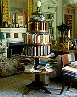 A Louis XIV etagere serves as a book carousel in this neo-classical library