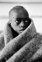 Burundi. Karuzi Province. Buhiga. The non-governmental organization (NGO) Médecins Sans Frontières (MSF) runs a  therapeutic feeding center (TFC) for malnourished children. Malnourished child wrapped round in a blanket. © 2000 Didier Ruef