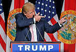 Donald Trump mimics shooting a gun talking about shooting military deserters by firing squad in the past during his first presidential campaign rally in Florida at the Trump National Doral Miami resort on Friday, October 23, 2015.