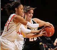 Dec. 18, 2010; Charlottesville, VA, USA; UMBC Retrievers guard Michelle Kurowski (20) fights for the loose ball with Virginia Cavaliers guard Ataira Franklin (23) during the game at the John Paul Jones Arena.  Mandatory Credit: Andrew Shurtleff
